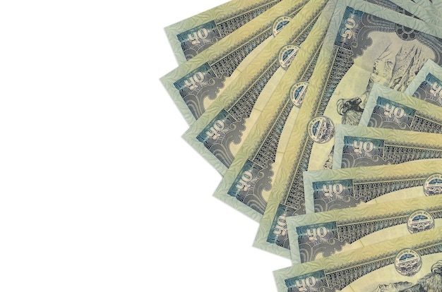Nepalese rupees bills laying on white surface