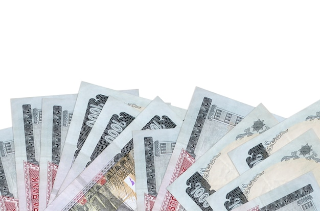 Nepalese rupees bills lies on bottom side of screen isolated on white