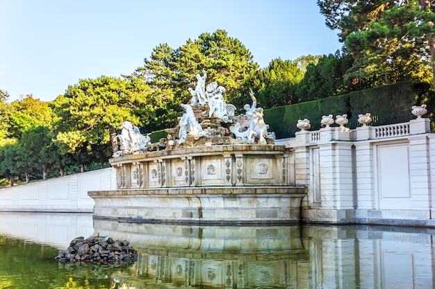 The neptune fountain in the schonbrunn palace park, vienna.