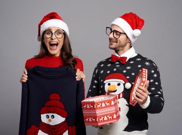 Nerd couple opening christmas present