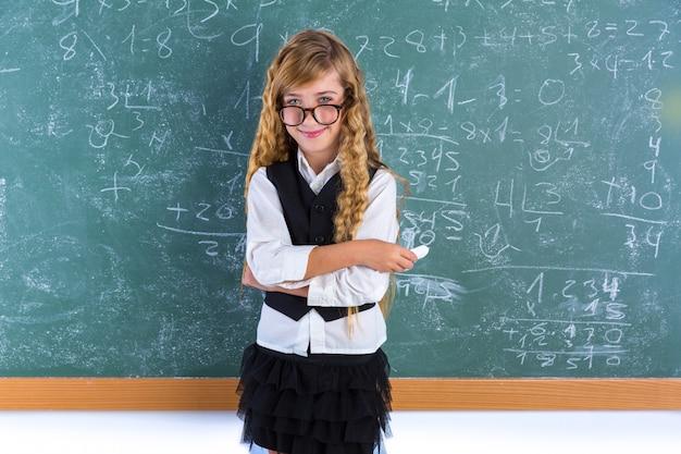 Nerd pupil blond girl in green board schoolgirl