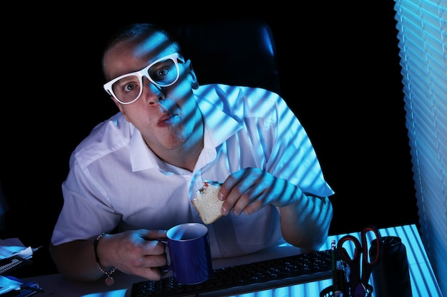 Nerd surfing internet at night time