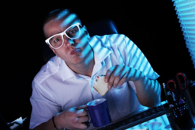 Nerd surfing internet at night time