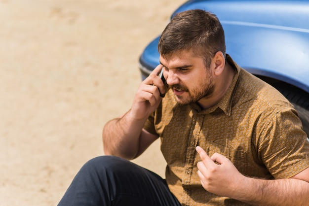Nervous driver calls to the help desk by phone