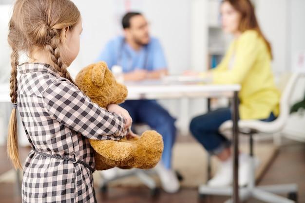 Nervous little girl in doctor's office