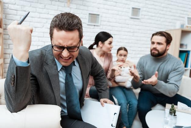 Nervous psychologist thinking family fighting