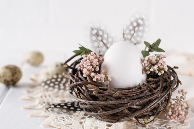 Nest with white chicken egg. easter concept. happy easter  or spring greeting card