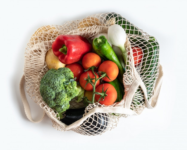 Net bag for shopping with fresh seasonal vegetables. top view