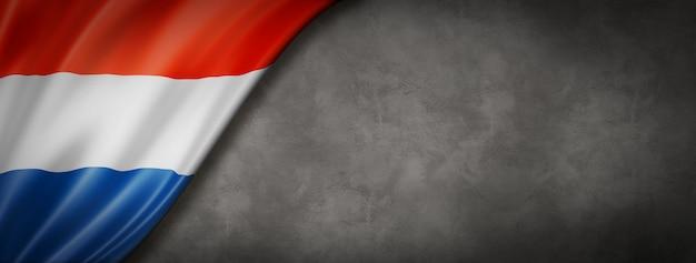 Netherlands flag on concrete background