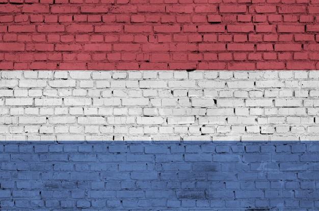 Netherlands flag is painted onto an old brick wall