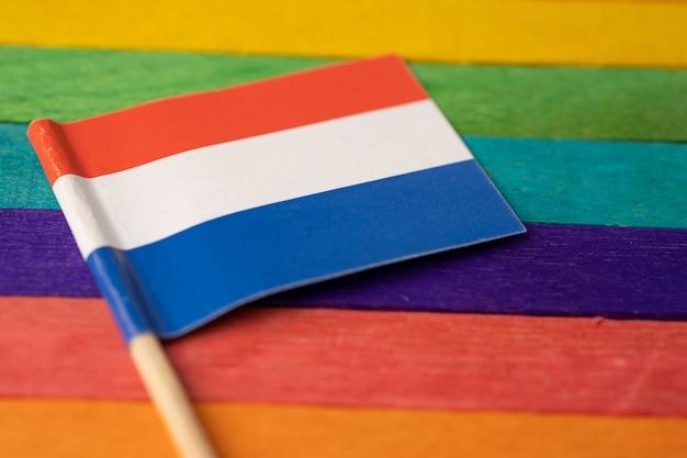 Netherlandsflag on rainbow flag.