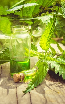 The nettle extract in a small jar. selective focus.