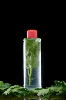 Nettle in a transparent plastic bottle with a red cap