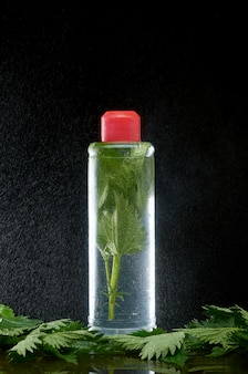 Nettles in a clear plastic bottle and water dust