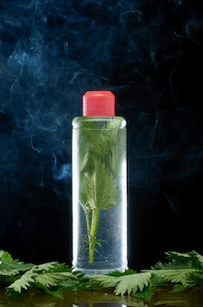 Nettles in a plastic bottle and a cloud of smoke