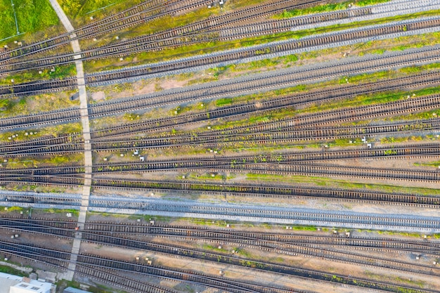 Network of railway tracks at a cargo station, top view.