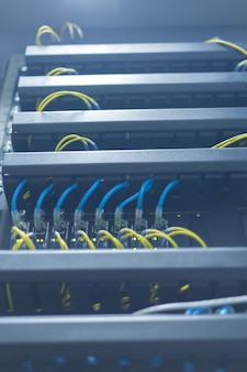 Network switch and ethernet cables, data center concept.