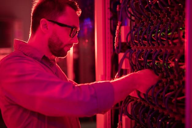 Network technician fixing supercomputer