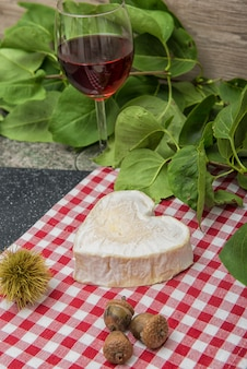 Neufchatel cheese on a red and white tablecloth