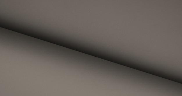 Нейтральный элегантный гладкий серо-бежевый цвет. свернутая пустая бумажная предпосылка текстуры.