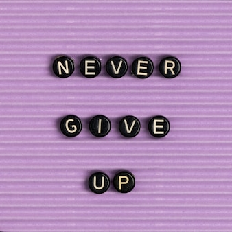 Never give up beads text typography