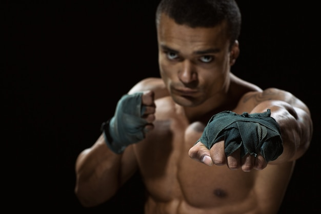 Never let emotions rule. selective focus on a fist of a male fighter
