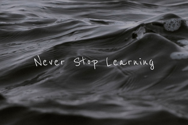 Never stop learning quote on a water wave