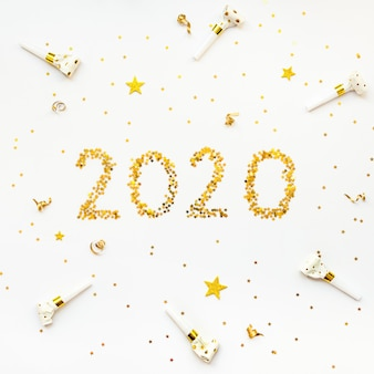 New 2020 year golden star shaped confetti background.