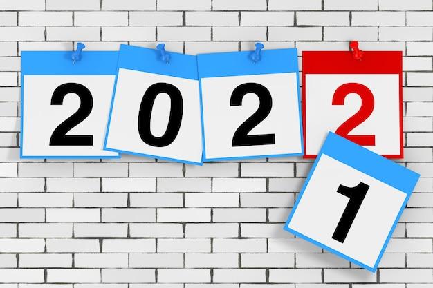 新しい2022年のスタートコンセプト。レンガの壁の前に2022年の新年のサインが付いたカレンダーシート。 3dレンダリング