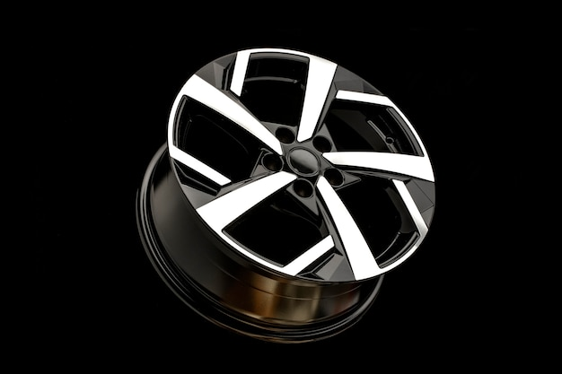 New alloy wheels on a black background. stylish and beautiful. auto parts and auto tuning.