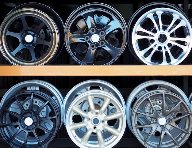 New alloy wheels  in modern tire store with stand.