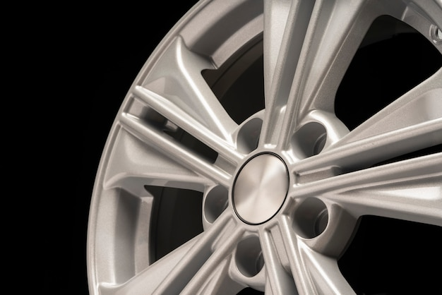New aluminum alloy wheel, silver color on a black wall