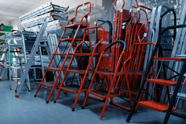 New aluminum stepladders in tool store, nobody. showcase with ladders, choice of equipment in hardware shop, instrument supermarket