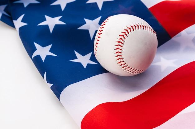 New baseball ball on american flag