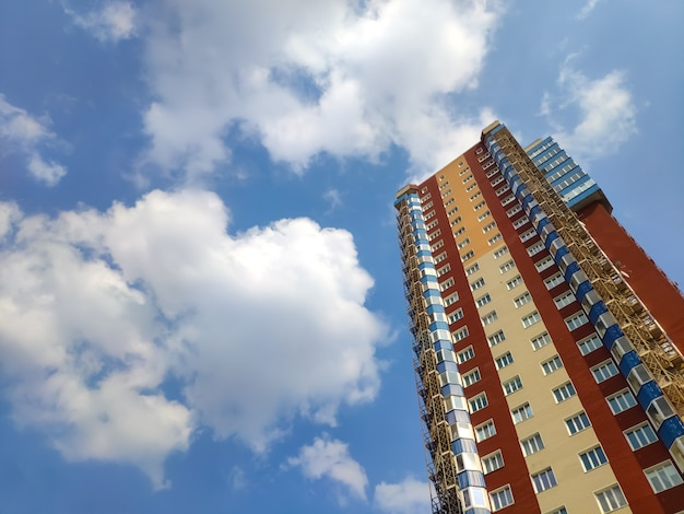 New block of modern apartments with balconies and blue sky