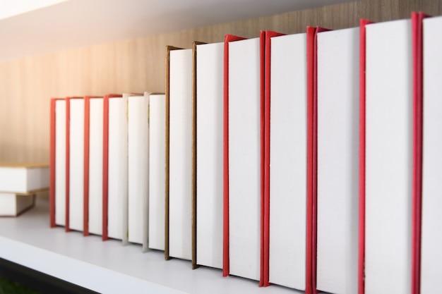 New books on a wooden shelf