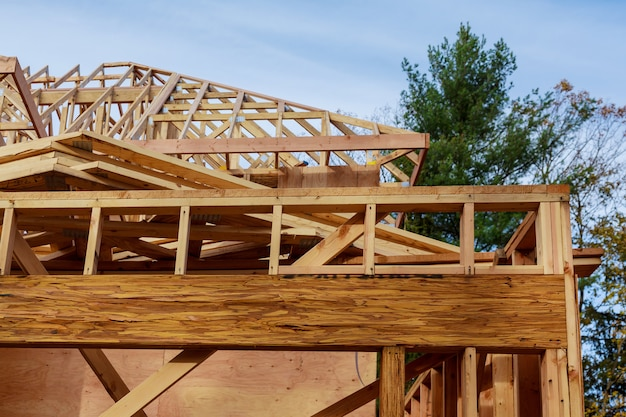 New build roof with wooden home construction framing timber frame house, real estate.