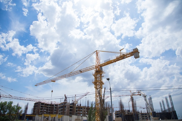 New building and cranes under the clouds