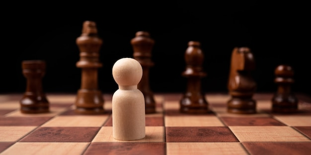 New business leader confrontation with king chess is a challenge for new business player, strategy and vision is key success. concept of competition and leadership