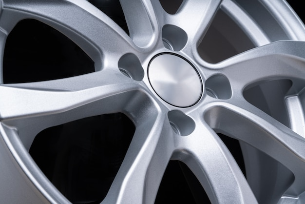 New car alloy wheel close up the spokes of the disc