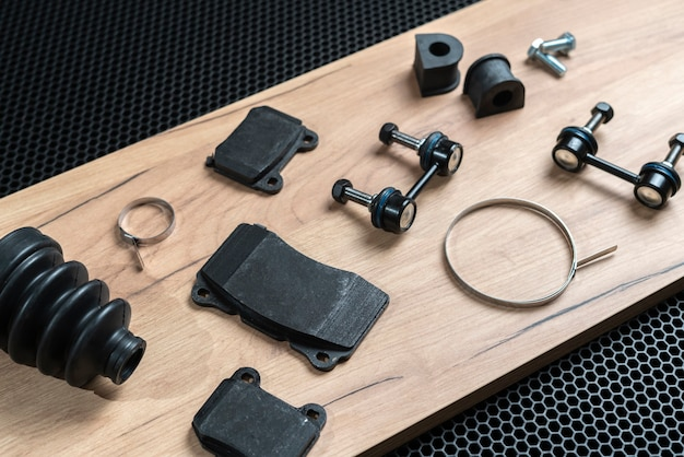 A new car spare parts collection flat lay on dark background, change details service