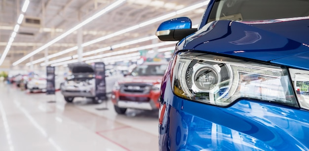 New cars in dealer showroom interior background