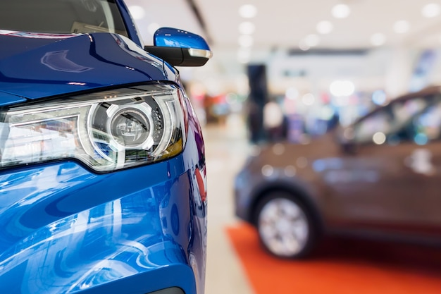 New cars in dealer showroom interior