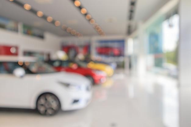 New cars in showroom blurred defocused background