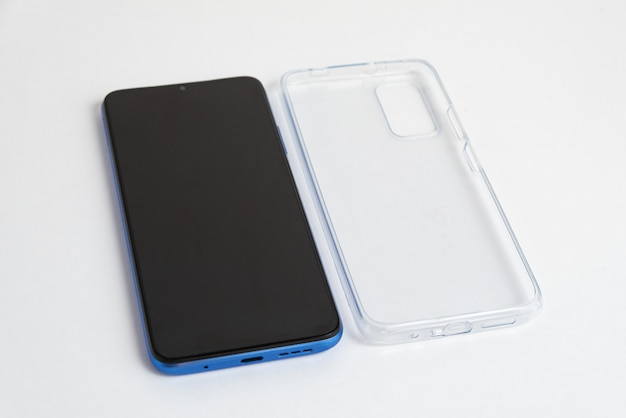 New cellphone with transparent cover over isolated white background