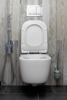 New ceramic toilet and shower in the bathroom.