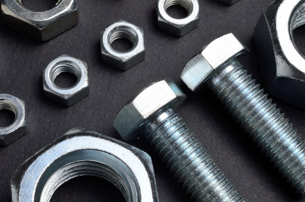 New chrome nuts and bolts of different sizes are laid out