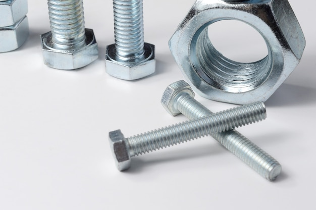 New chrome screw-nut of different sizes. concept.