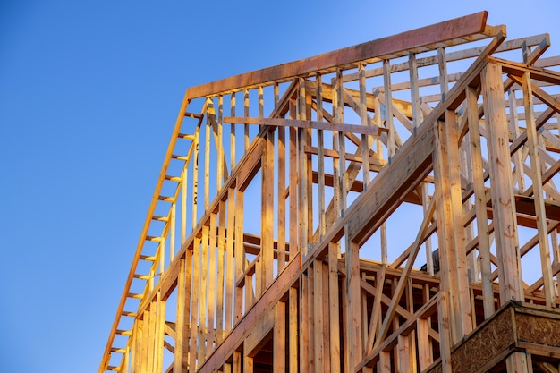 New construction home residential construction home framing against a blue sky