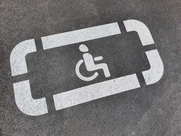 New disabled person sign painted on the new asphalt.